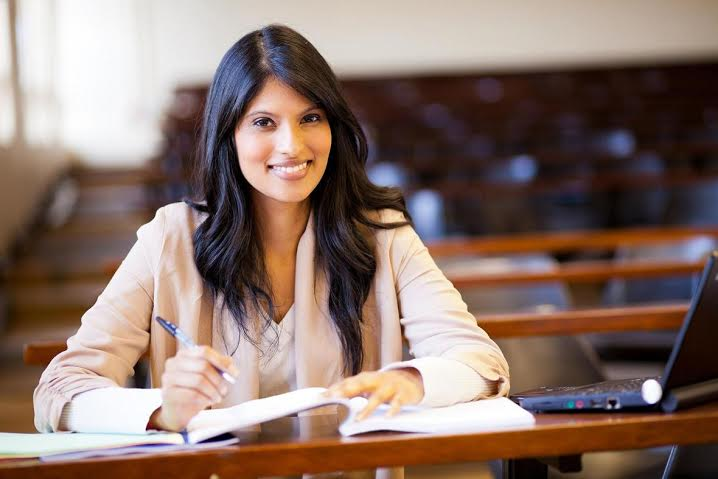 beautiful female indian college girl in lecture hall