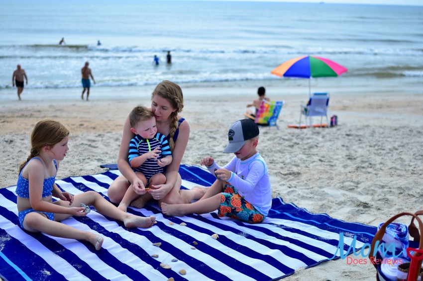 family sitting on CGEAR sand-free beach blanket