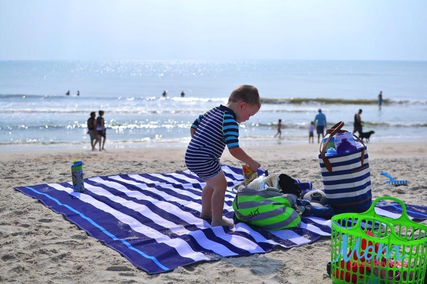 child playing on sand-free beach mat