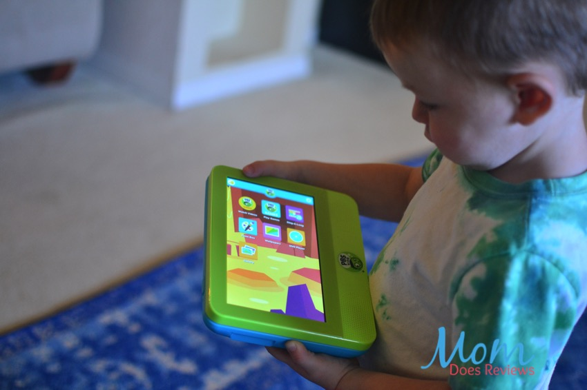 Toddler Playing PBS KIDS tablet
